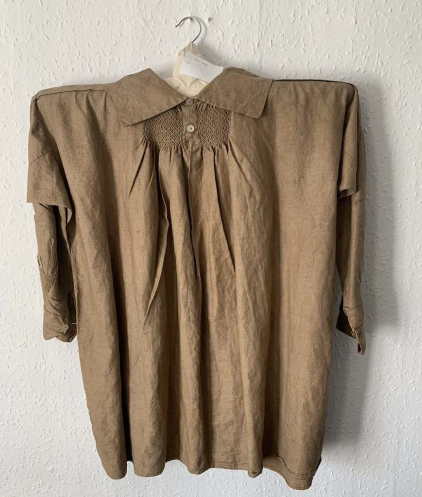 photo of a country smock with long sleeves, collar and emroidery