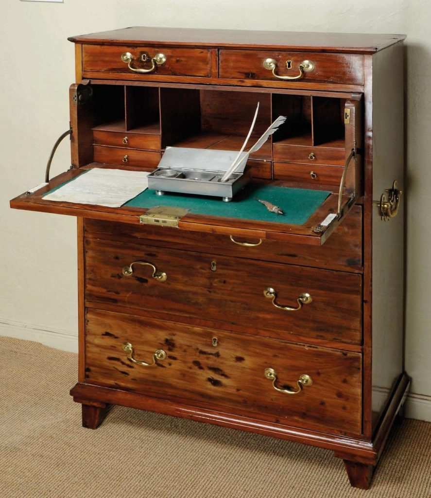 photo of a mahogany bereau type desk with fold down surface and drawers