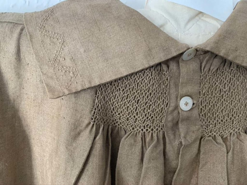detail picture of a smock collar with embroidery