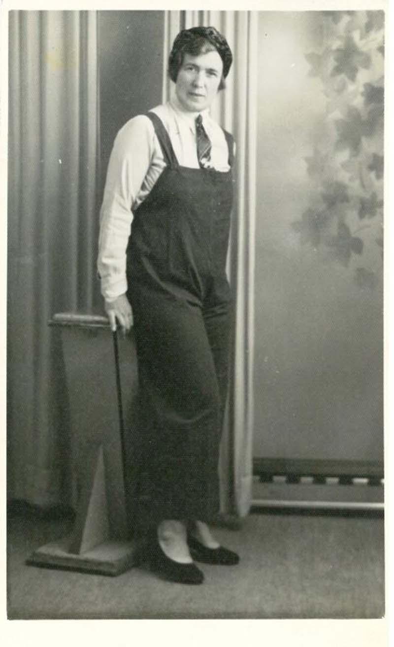 studio portrait of woman in workers overalls