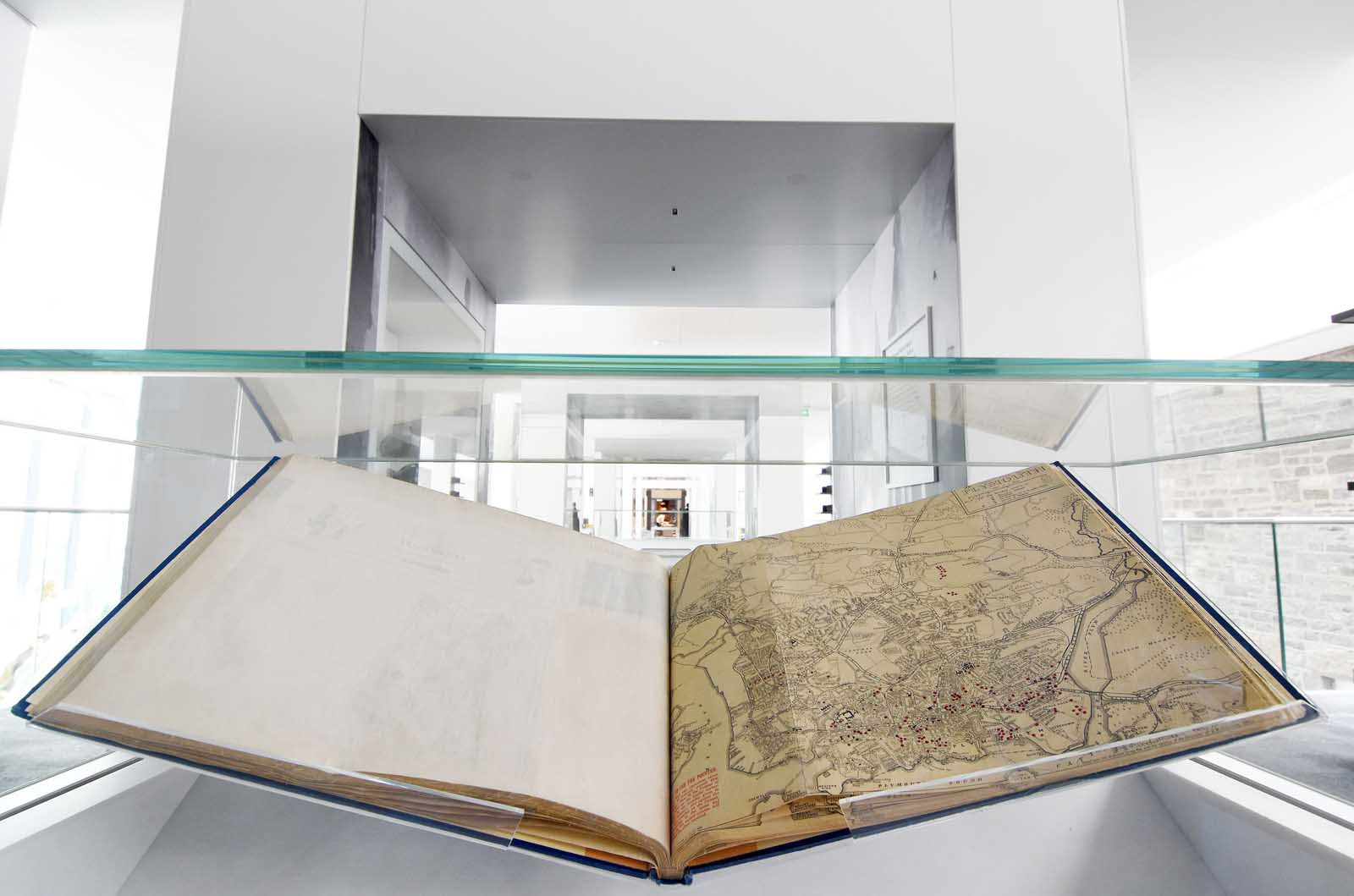 photo of a open book in a display case