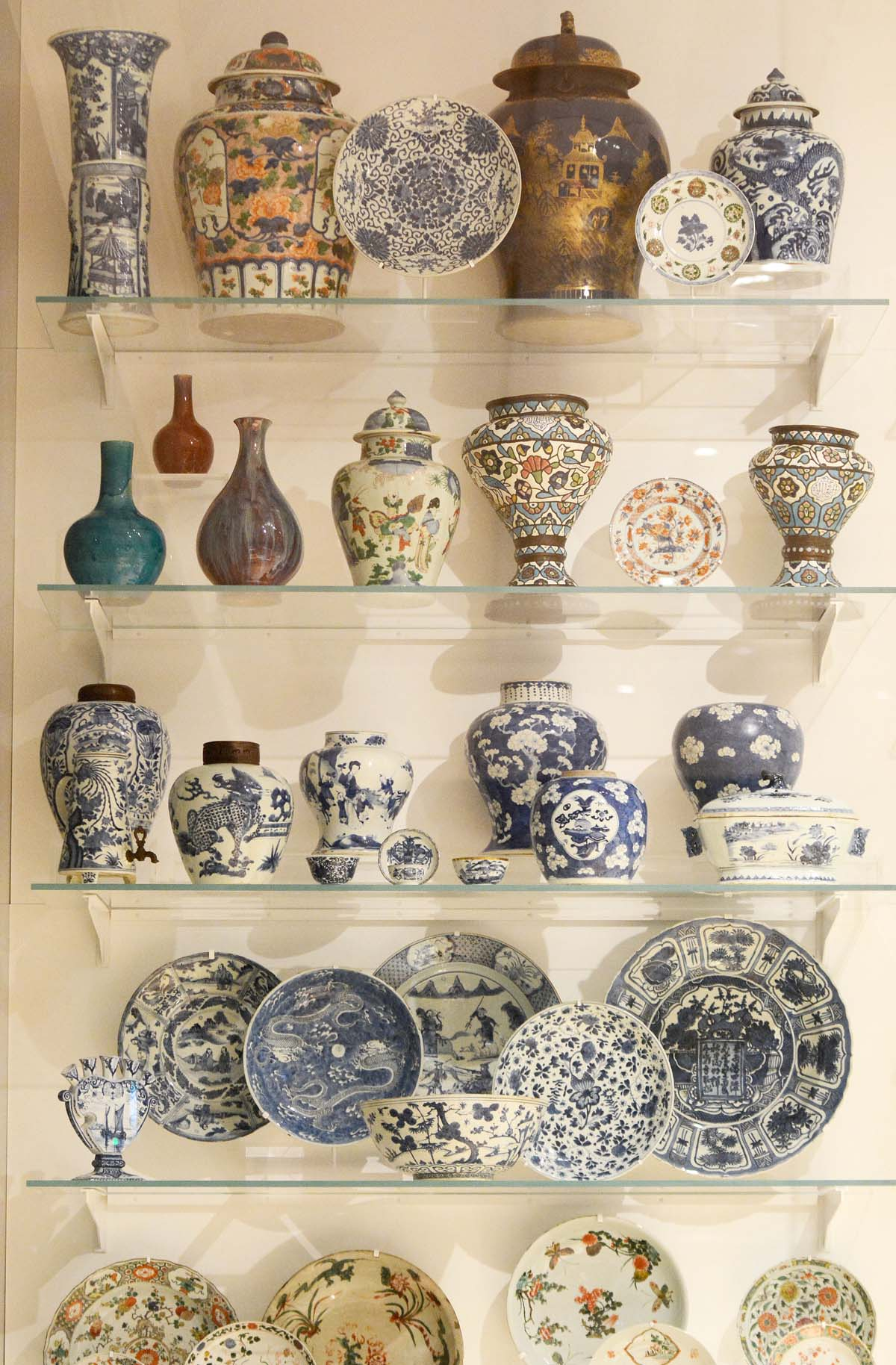 a display case with pots in it
