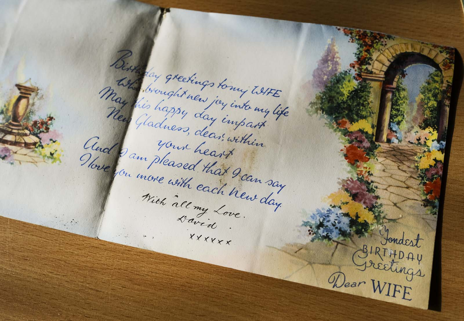 a fold out 1940s style illustrated letter with floral patterns