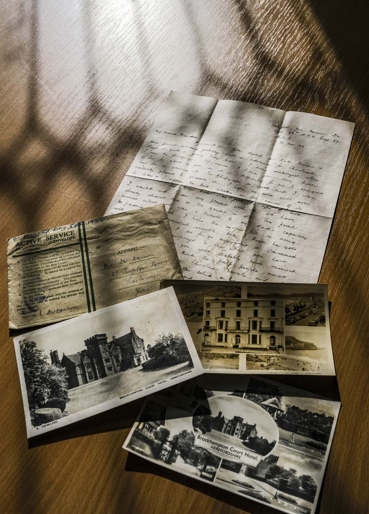 the collection of letters with postcards and photographs