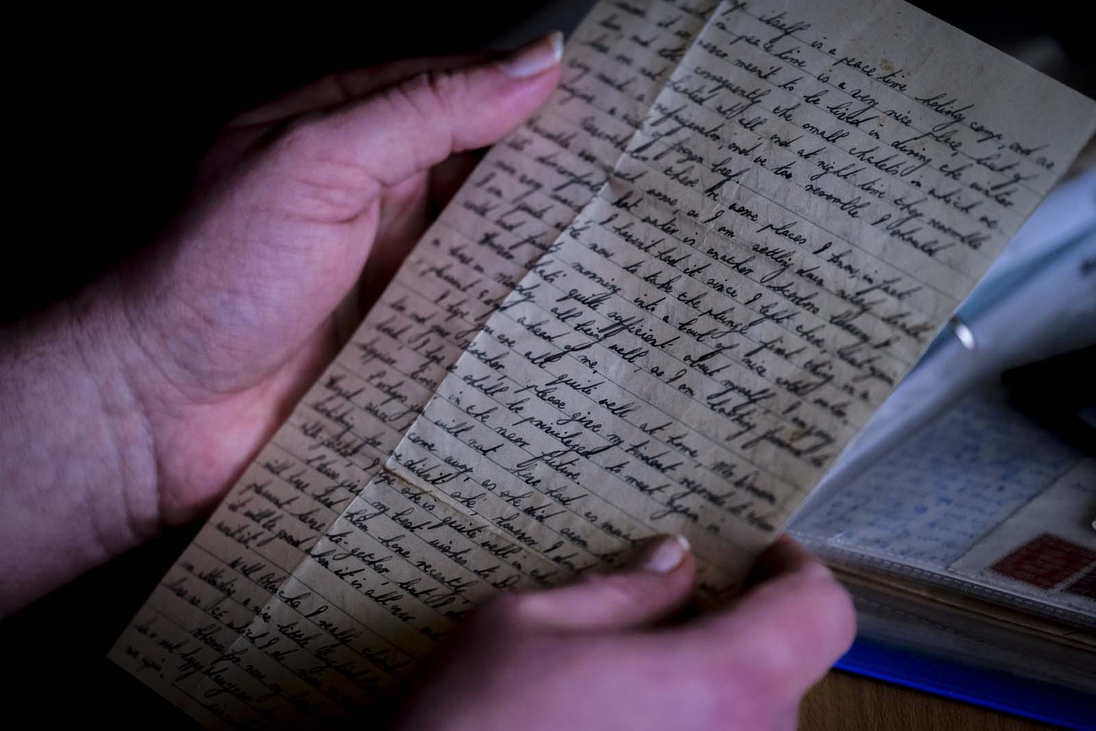 photo of a handwritten letter held in someone's hands