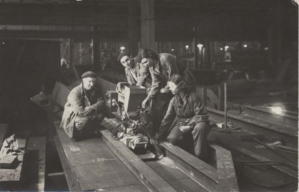 photo of women working in with men in an engineering works