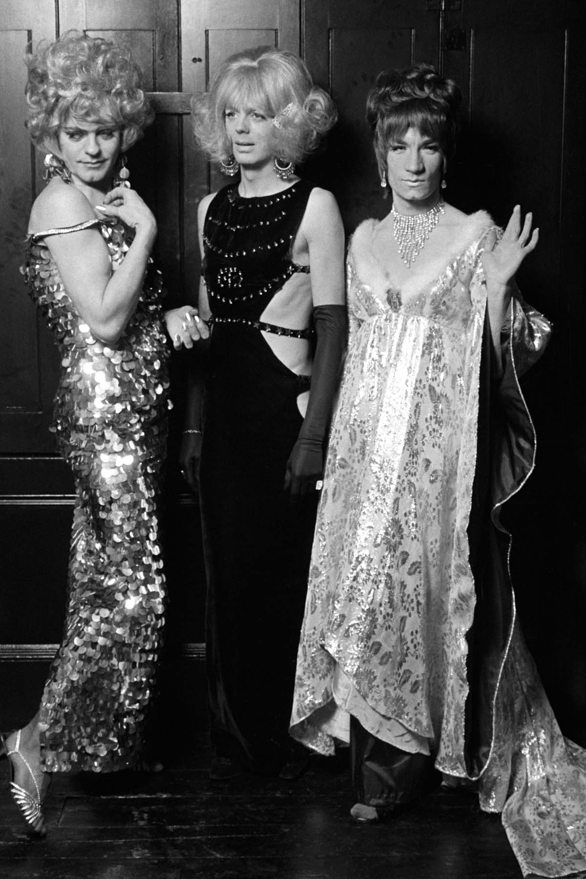 black and white photo of three men dressed in drag