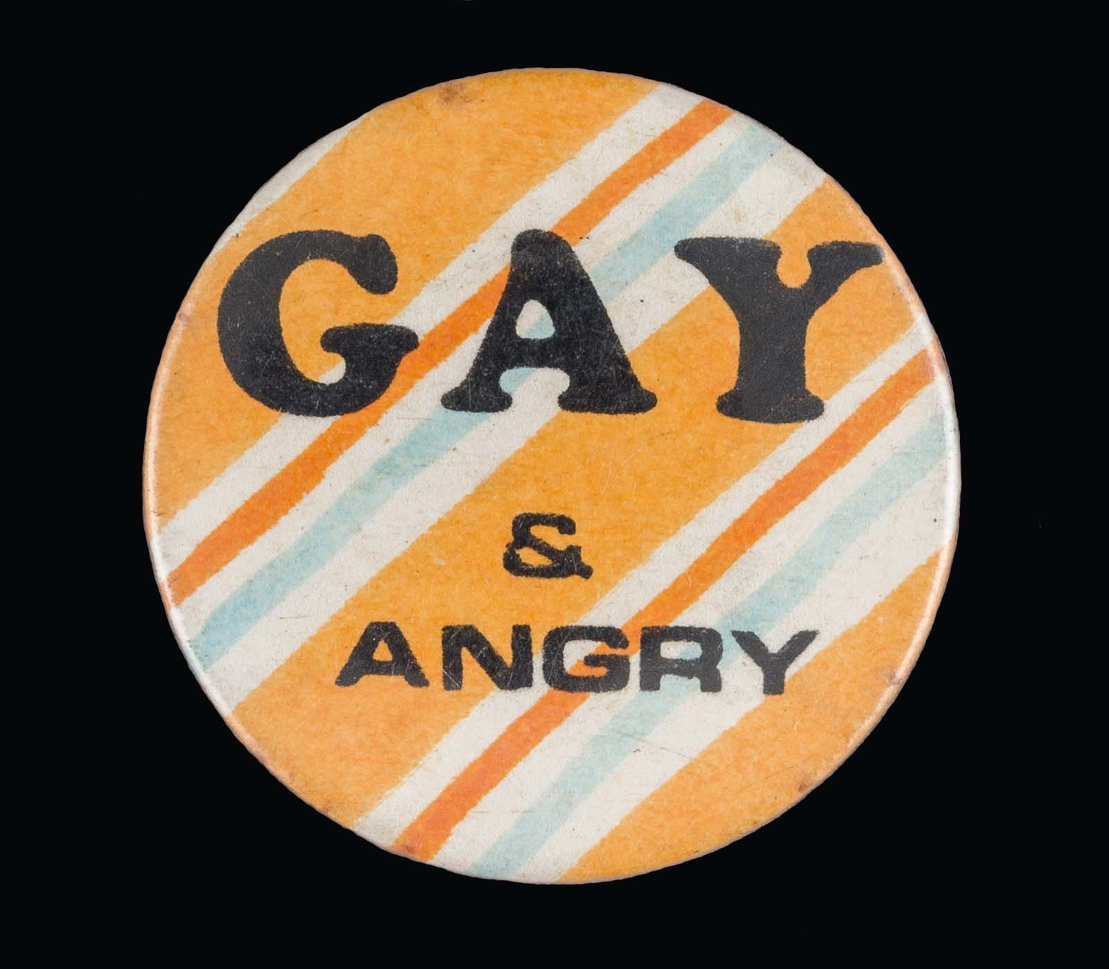 yellow and gray striped badge with the words Gay and Angry
