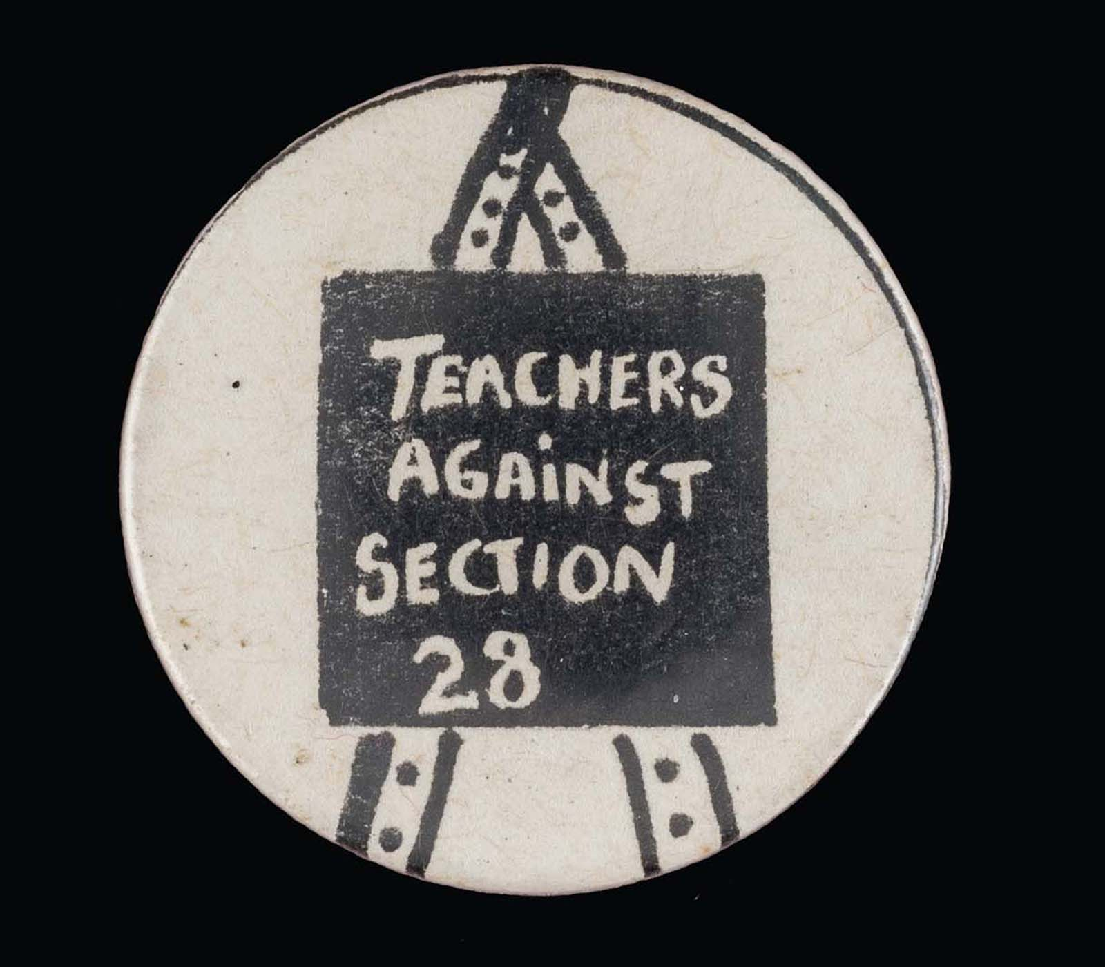badge with a drawing of a blackboard with the words teachers against section 28
