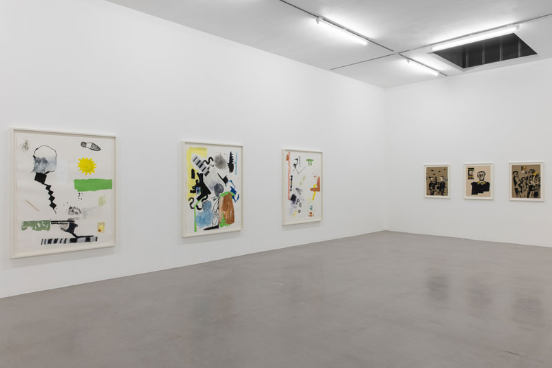 installation of abstract works on paper in a gallery setting