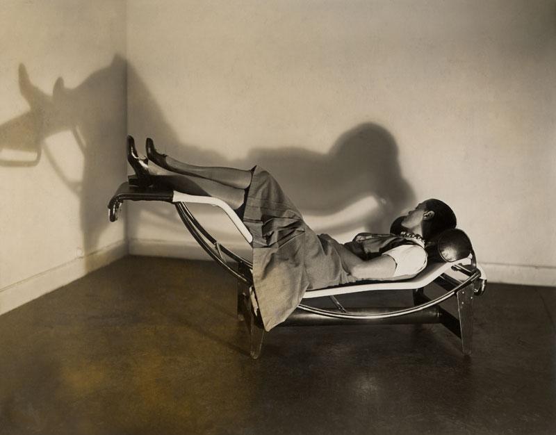 woman reclining in modern chair
