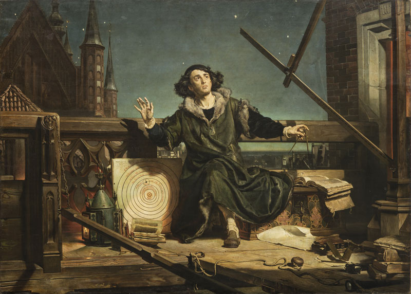 Copernicus on a balcony overlooking a city at night