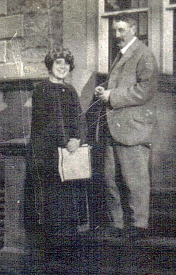 photo of a man and a young woman in early twentieth century clothes