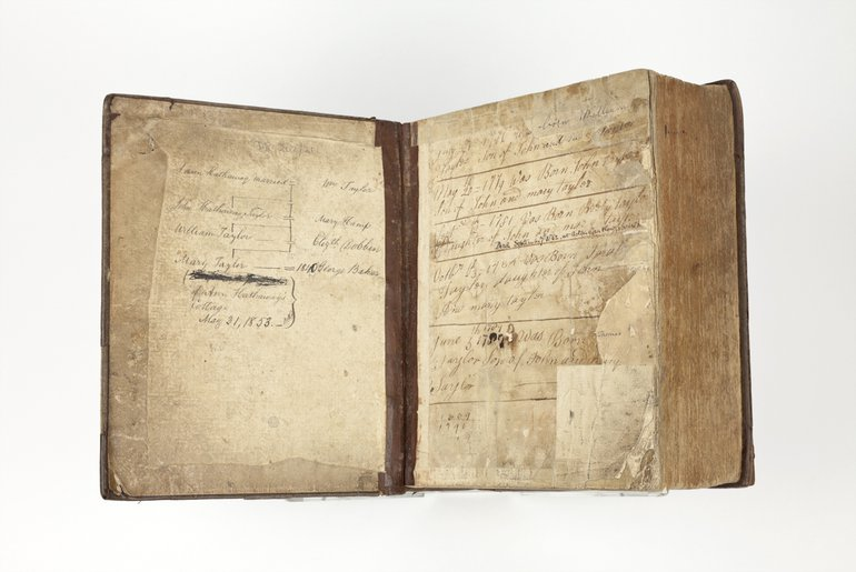 photo of an open book with handwritten inscriptions in the front