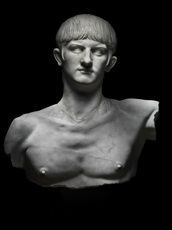 a marble bust representing head and upper torso of Nero on black background