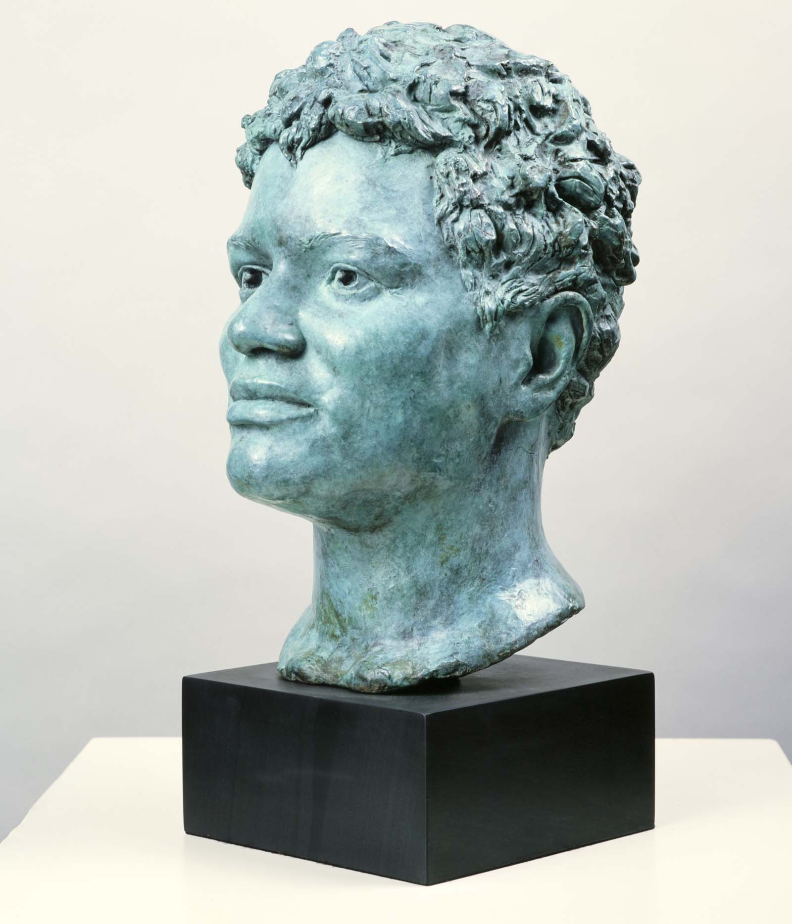 sculpted bronze head of a woman with short tight afro hair