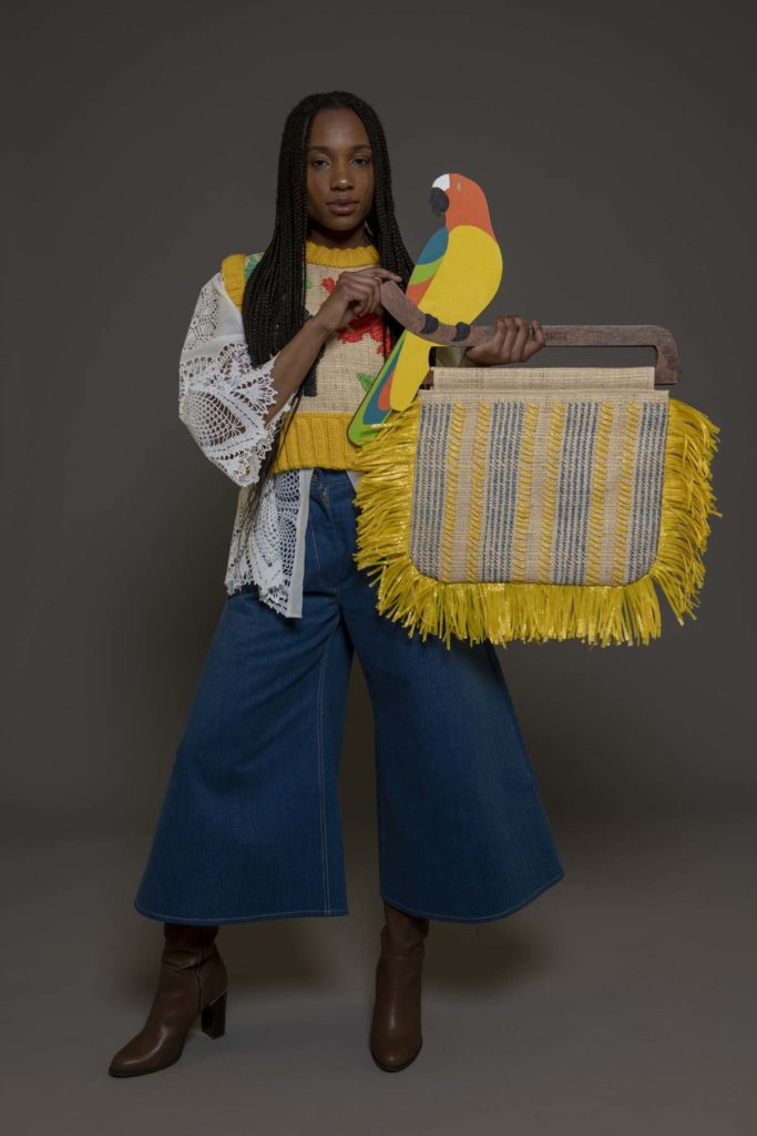 photo of a model wearing denim culottes, lace shirt and yellow woollen tank top with the words Black and British