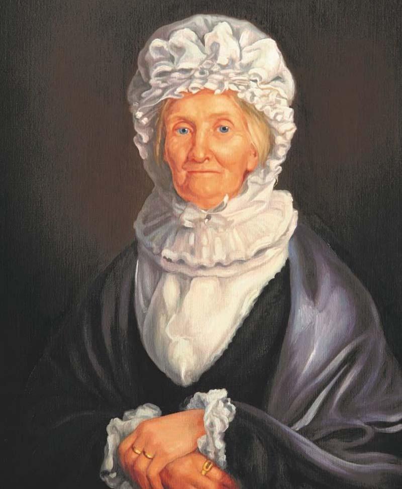 portrait of elderly woman wearing a silk white bonnet and black shawl