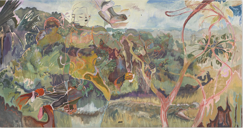 two figures barely visible on top of a lush landscape