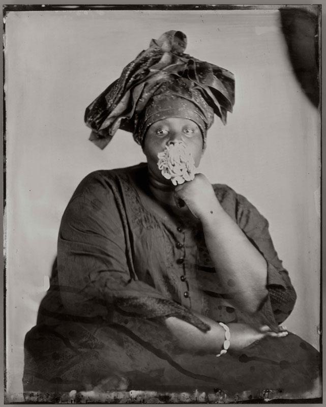 tintype photographic self portrait of artist Khadija Saye seated and wearing headscarf