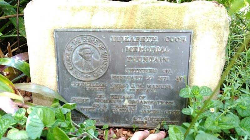 photo of a memorail stone with granite carved inscription to Elizabeth Cook with portrait roundel