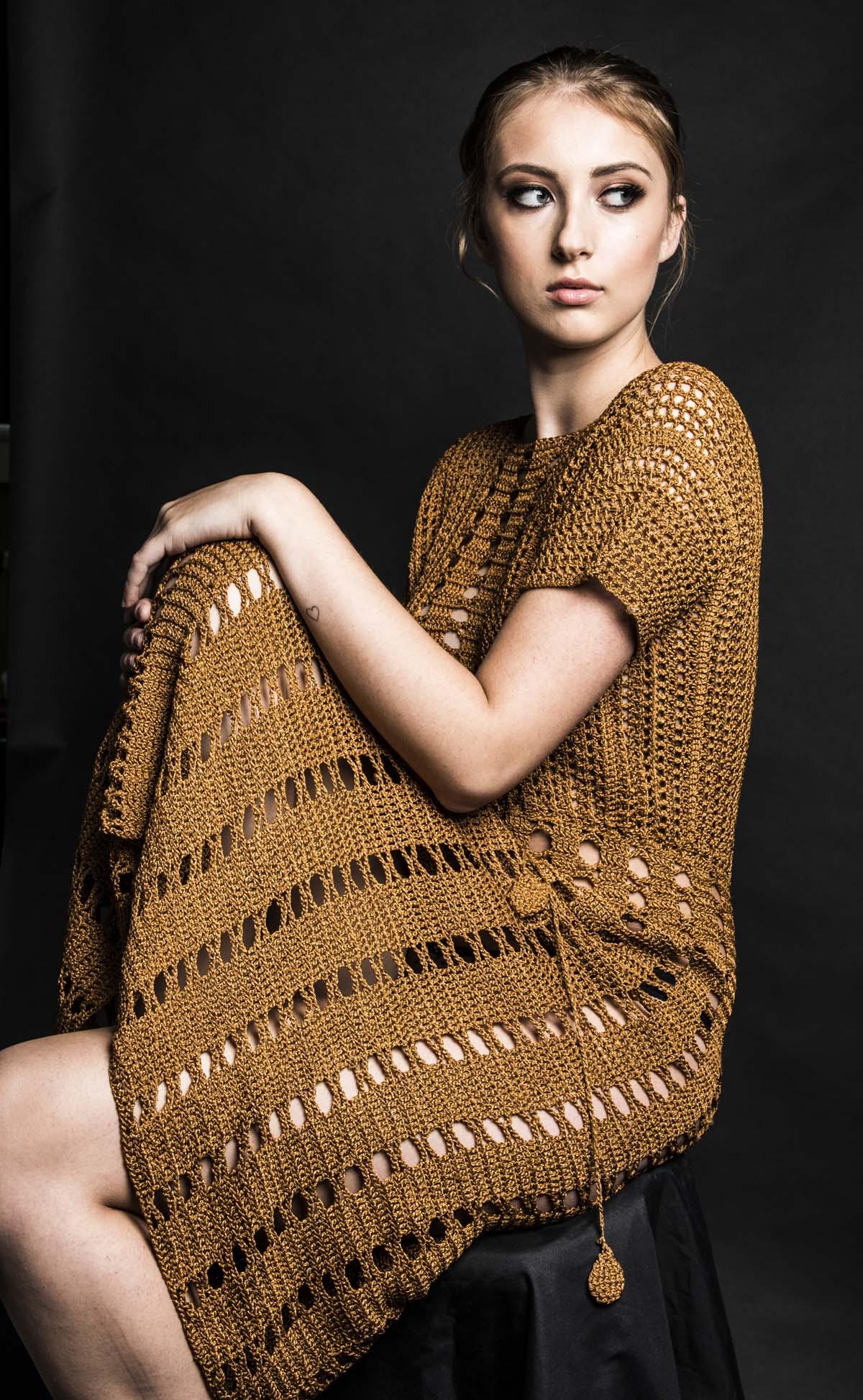 photo of a model wearing a long single piece dress in golden brown