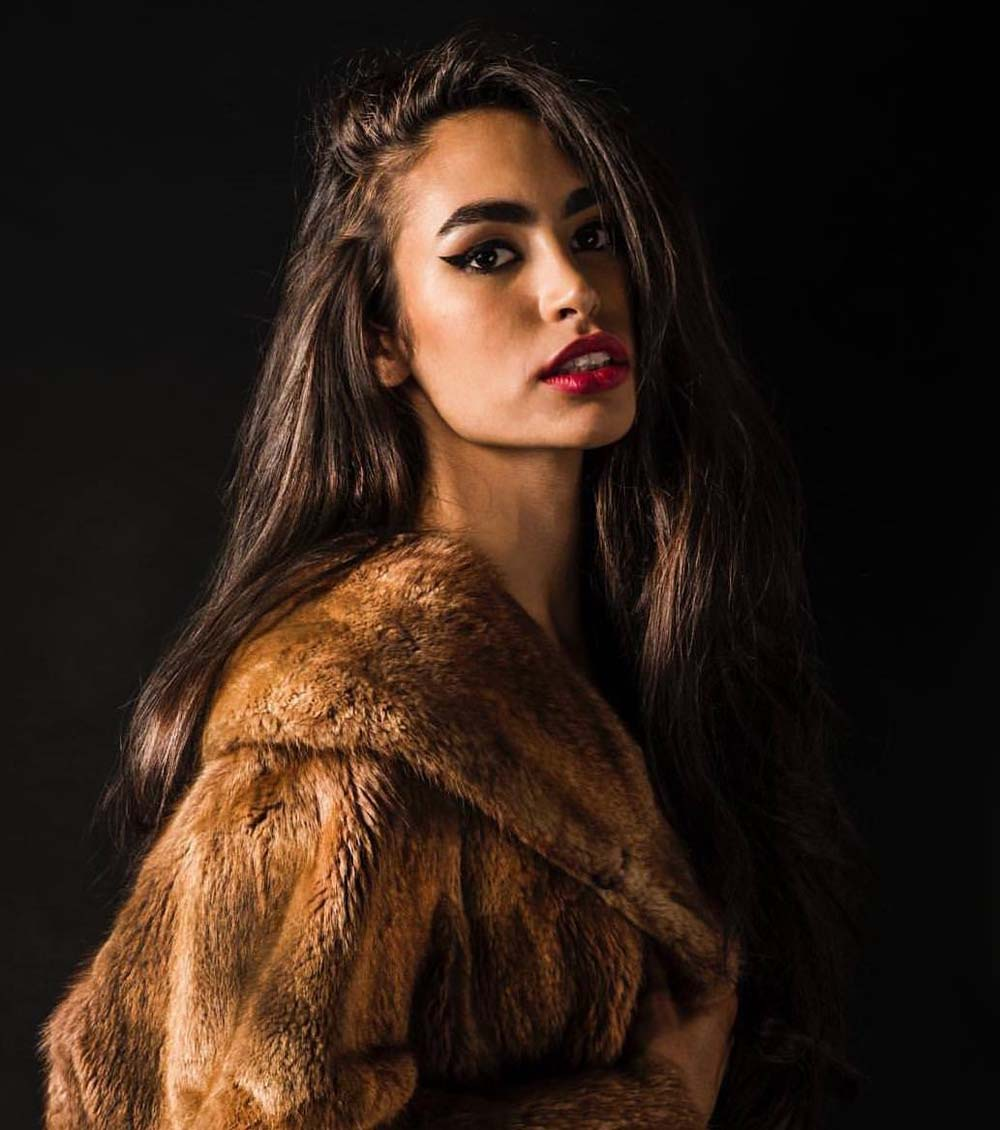 photo of a woman wearing a fur coat