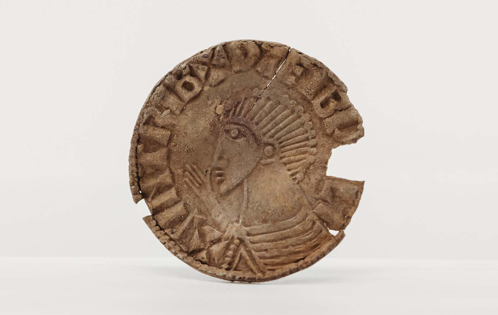 photo of a coin with kings head on it