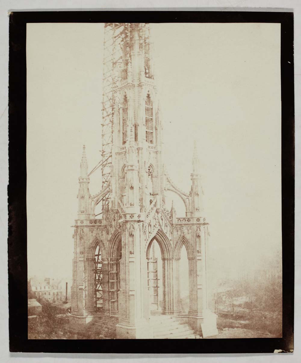 sepia photo of a spire like monument