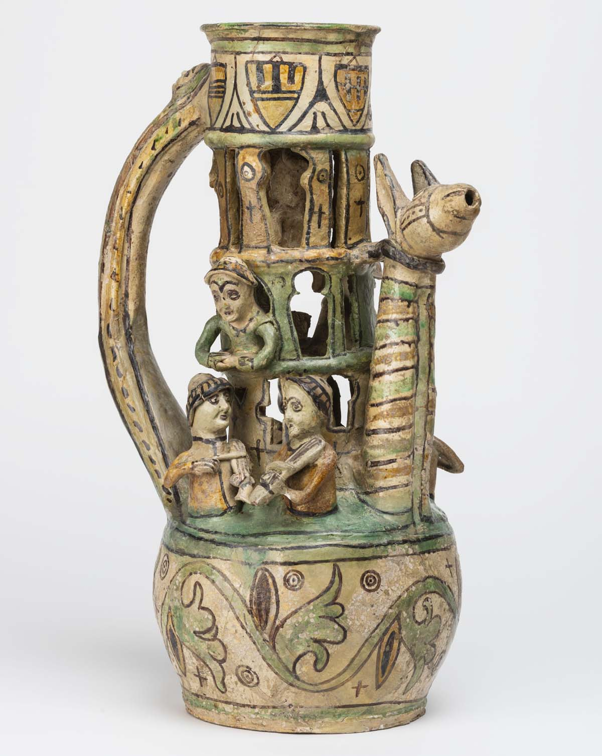 photo of a jug with figures and animals and holes in it