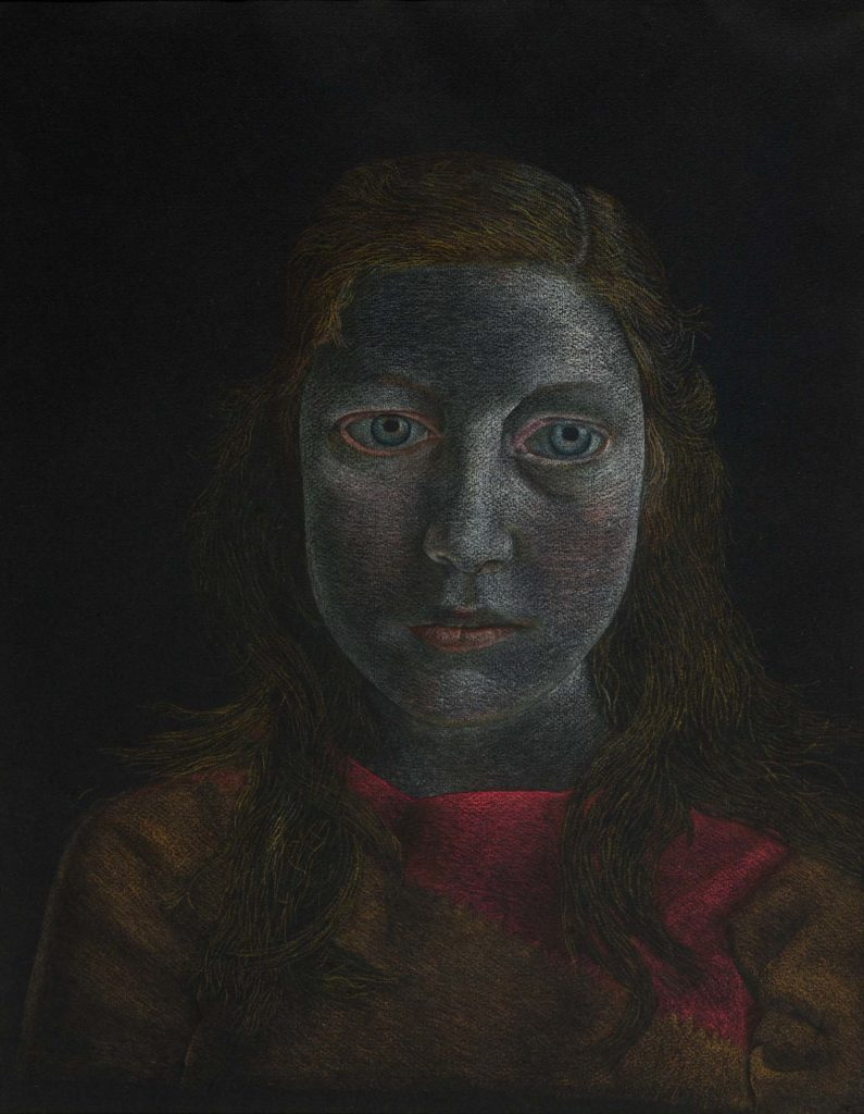 a dark portrait of a young woman