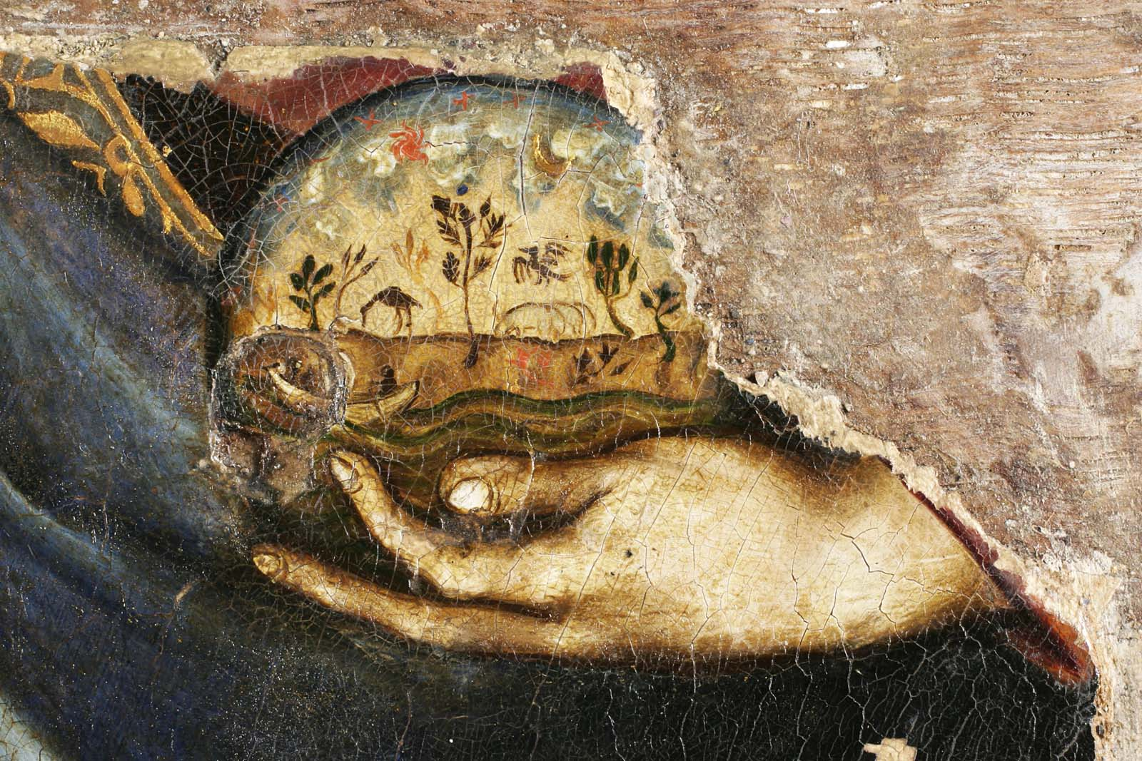 painted detail of a hand holding an orb