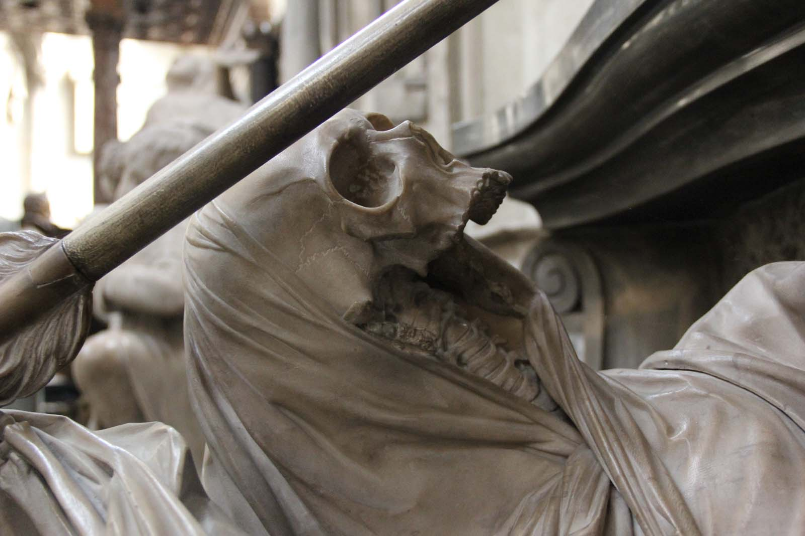 close up photo of a sculpture of a skeleton with a missing lower jaw