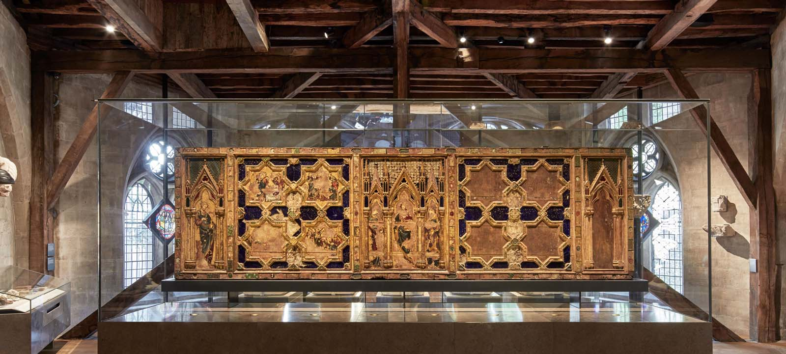 painted and gilded wood altarpiece with decorative metalwork, enamel, glass and other materials