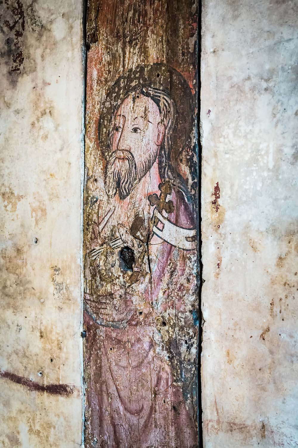 close up of a painting on a wall showing a bearded figure