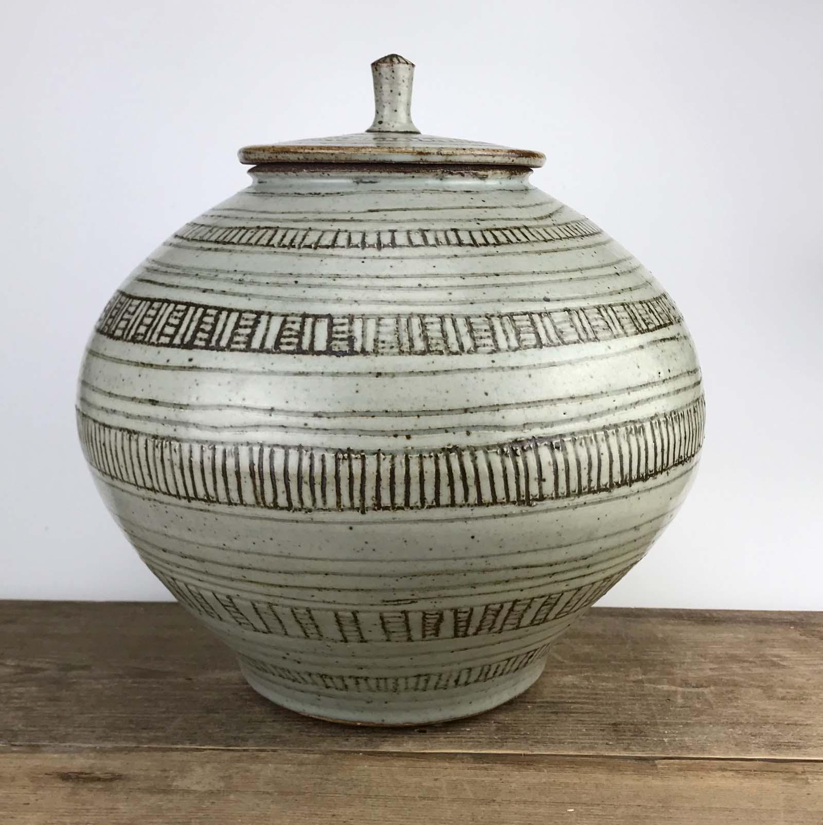 photo of a lidded stoneware jar