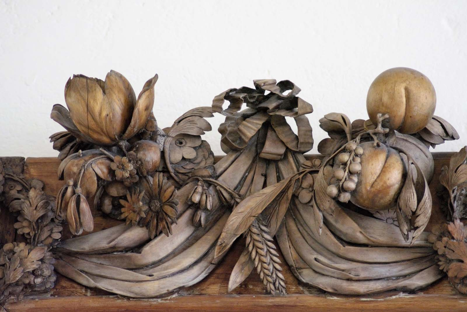 close up of wood carved fruit and leaves