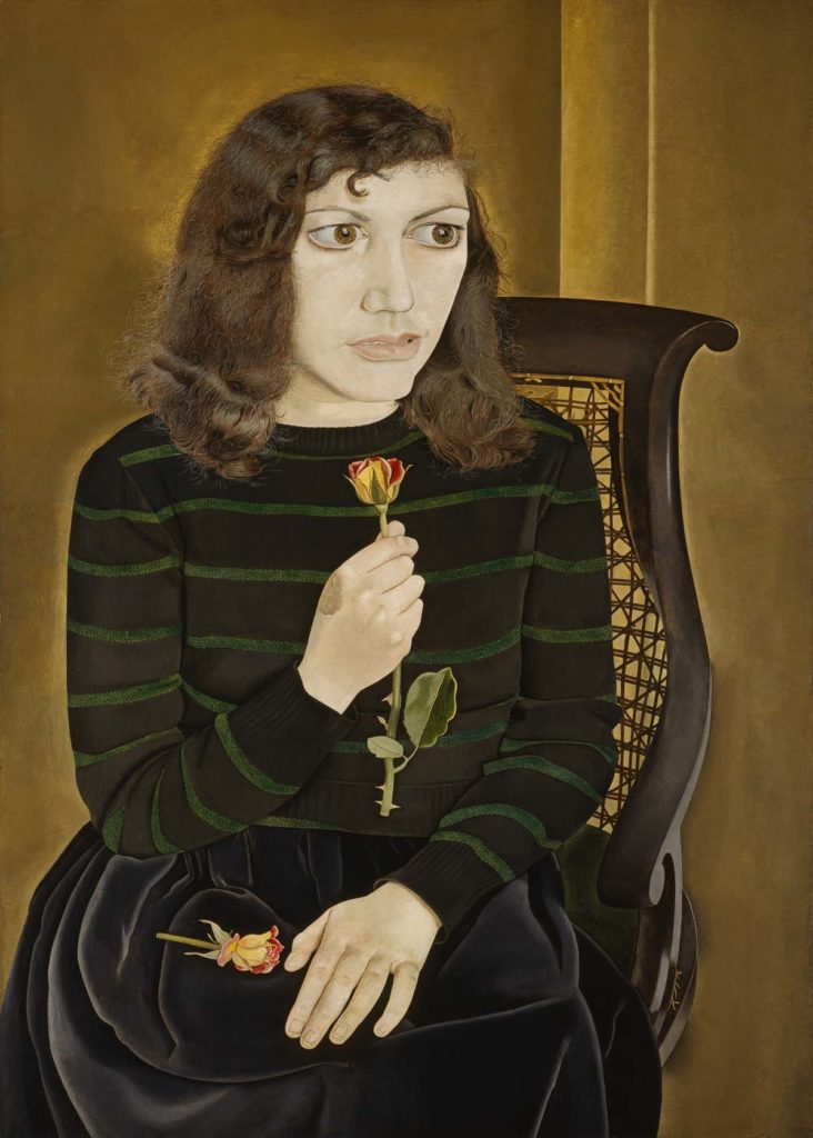 portrait of a young woman seated on a chair holding a single rose
