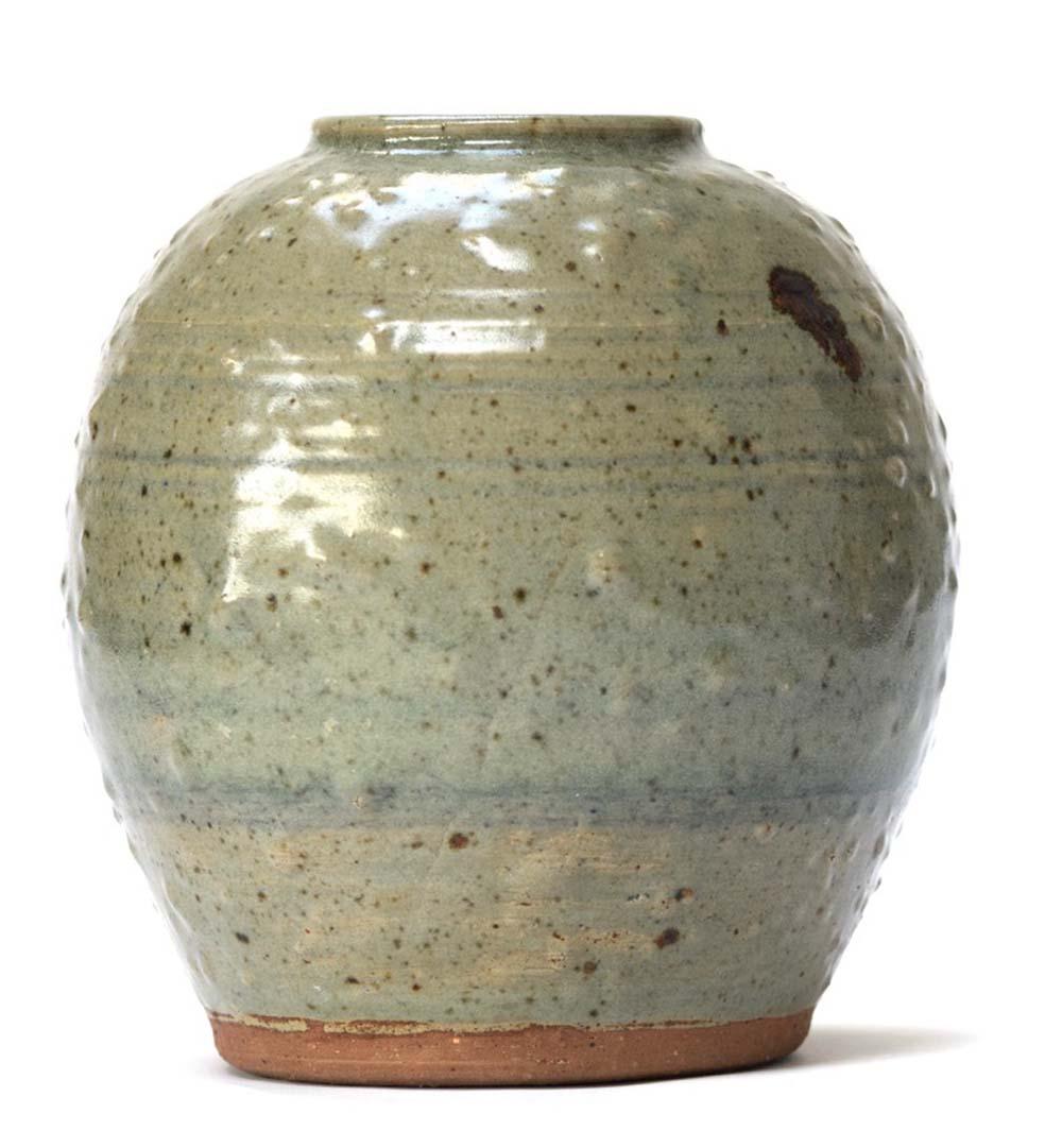 green glazed vase with rough finish
