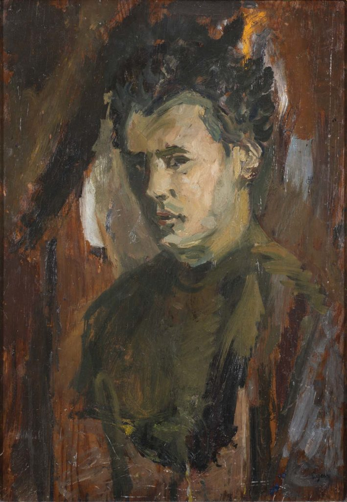 portrait of a young man in brown hues wearing a jumper