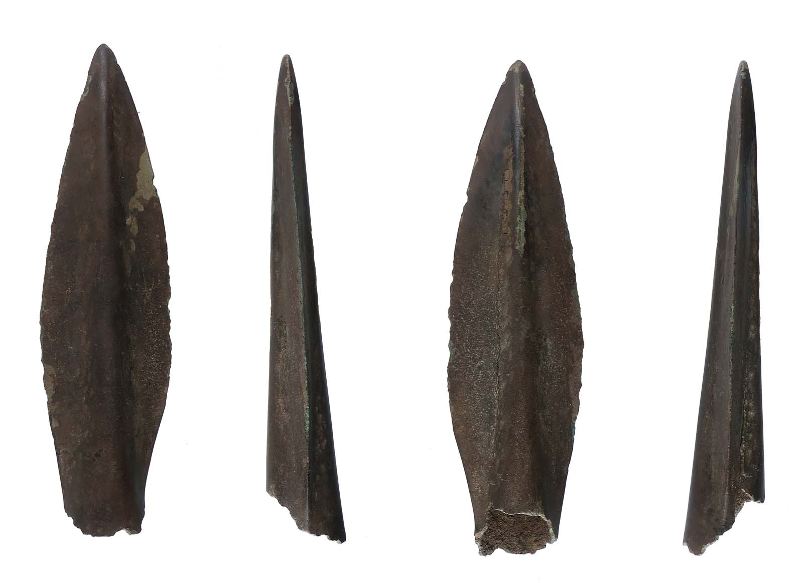 four views of a metal spearhead