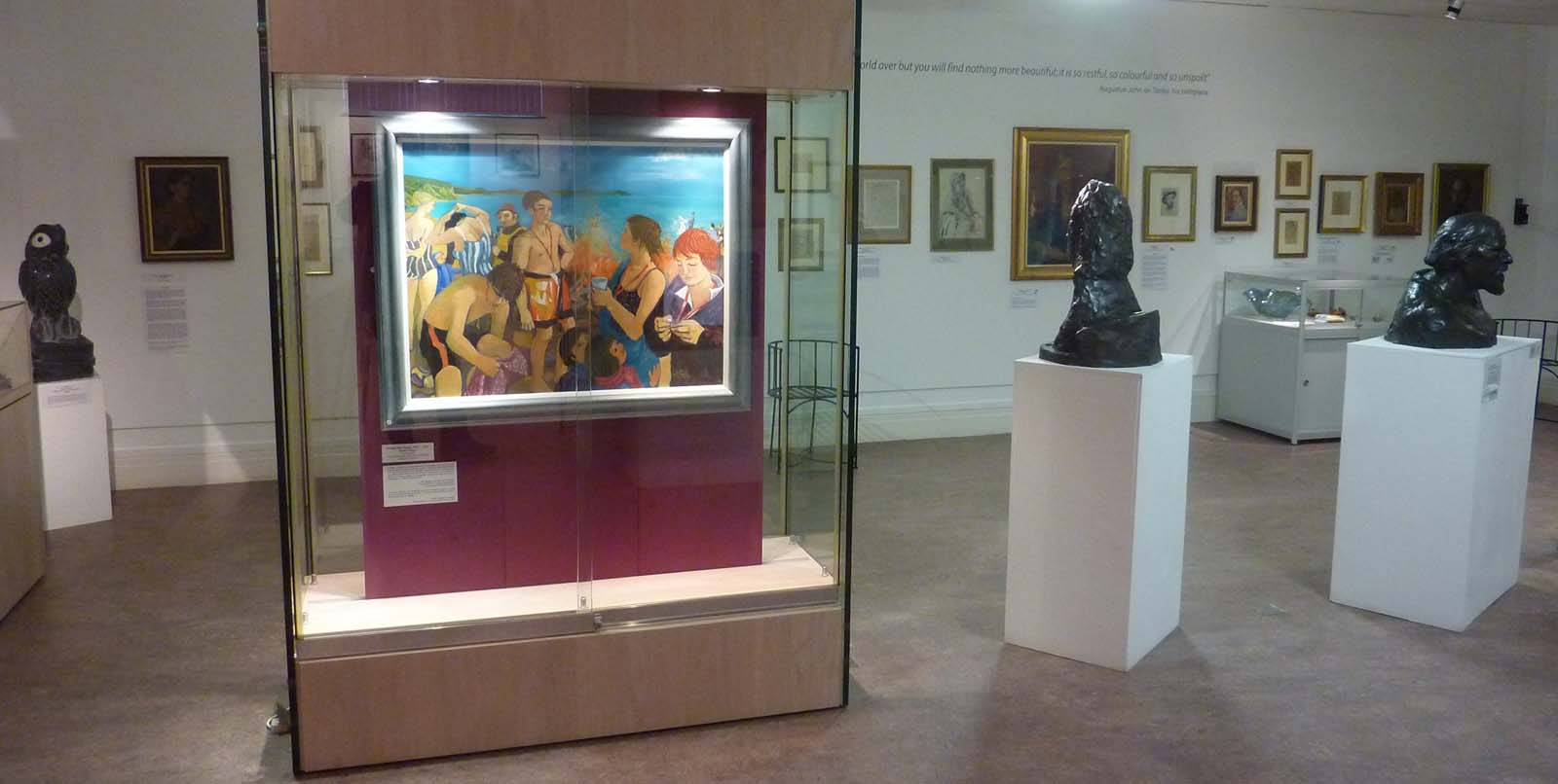 photo of a gallery with artworks