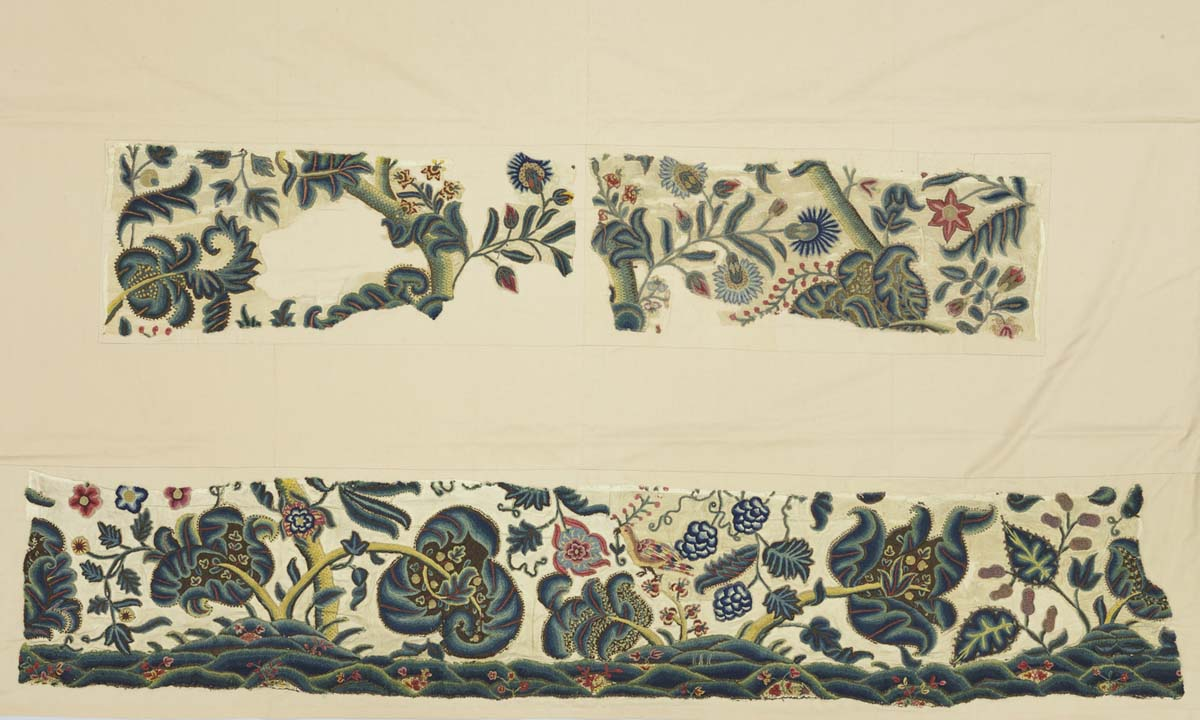 photo of two fragments of embroidery with plants and other motifs