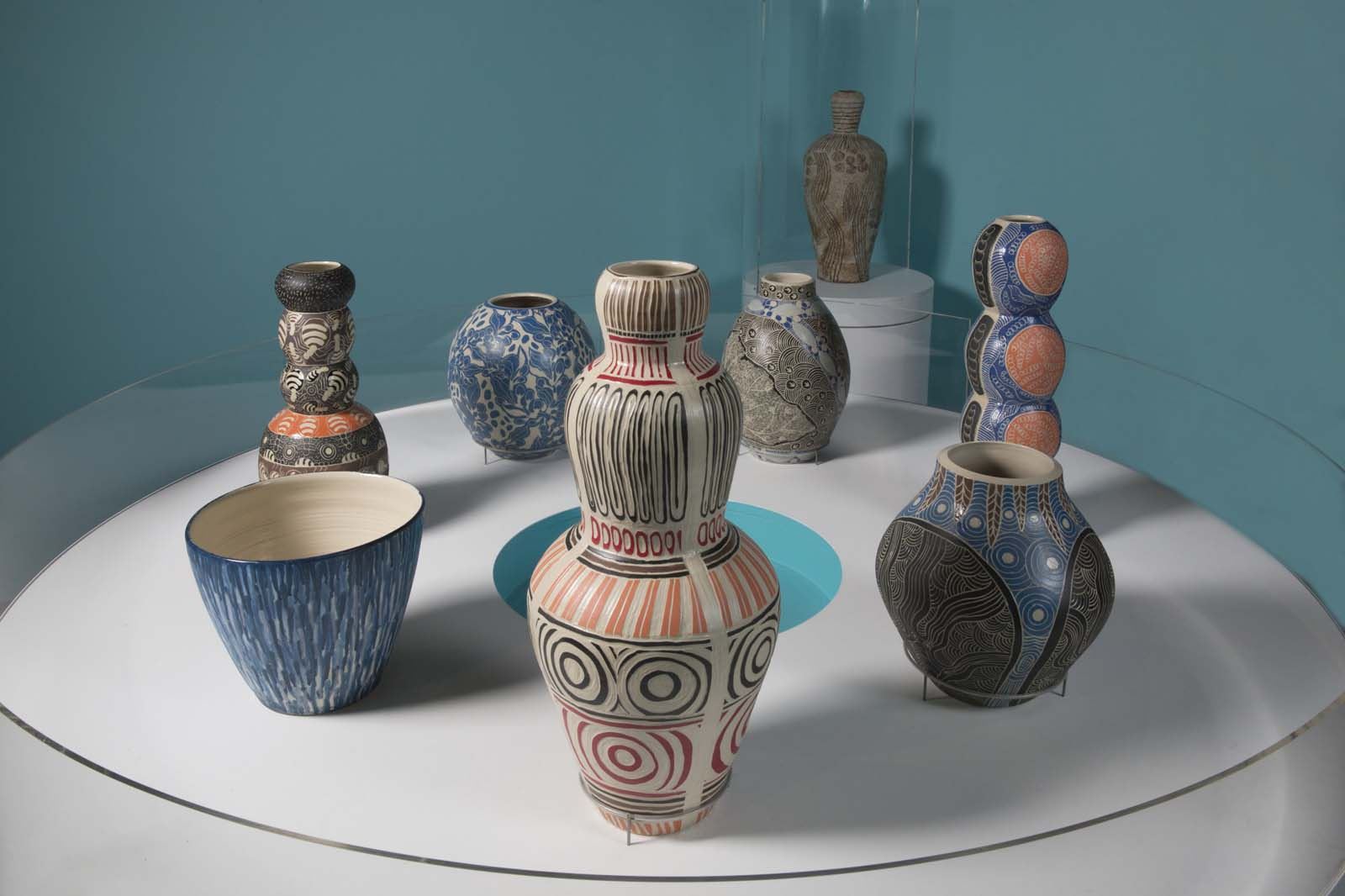 photo of a series of colourful ceramic vases