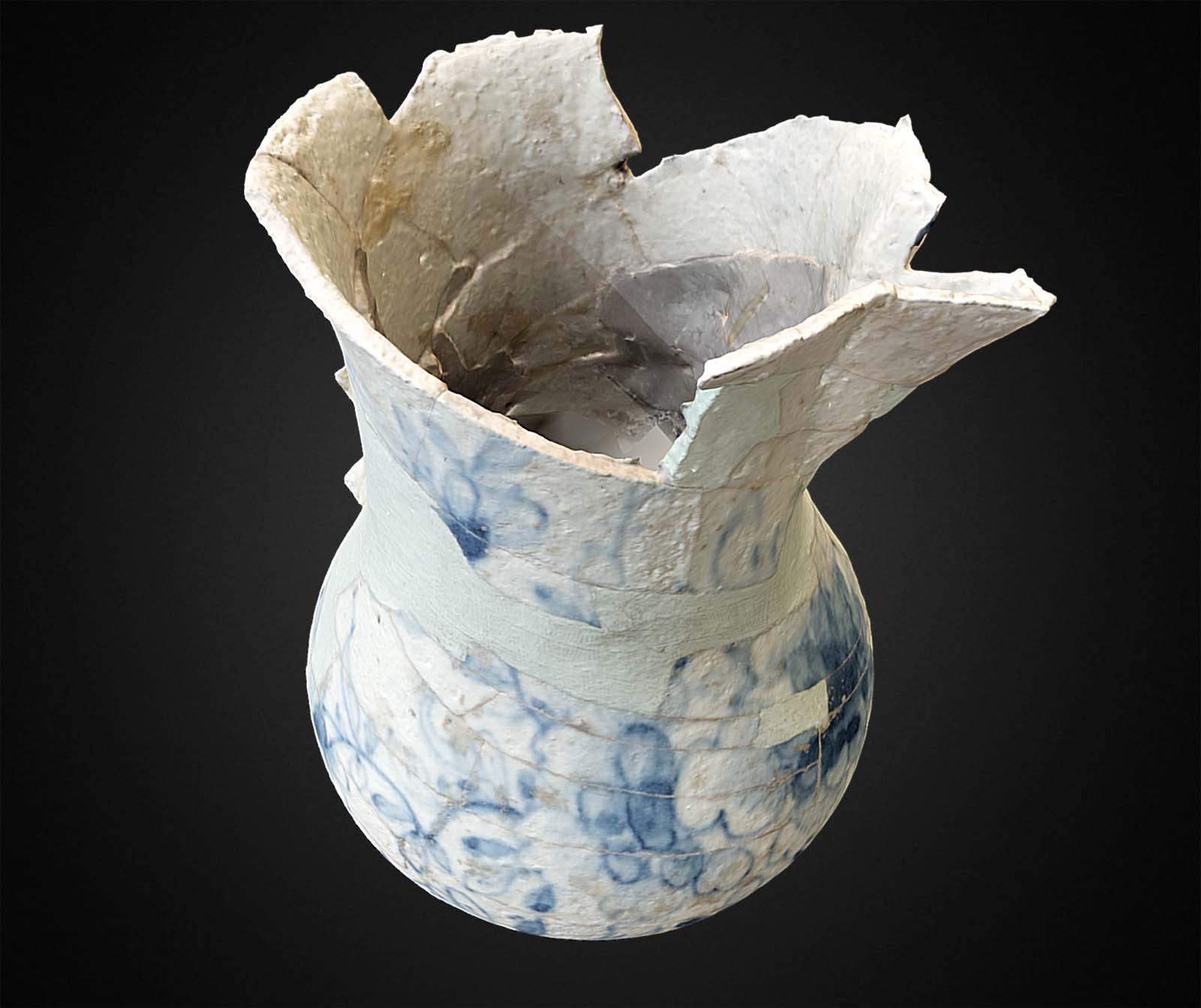 photo of a shattered porcelain vase reconstituted with tape and slip