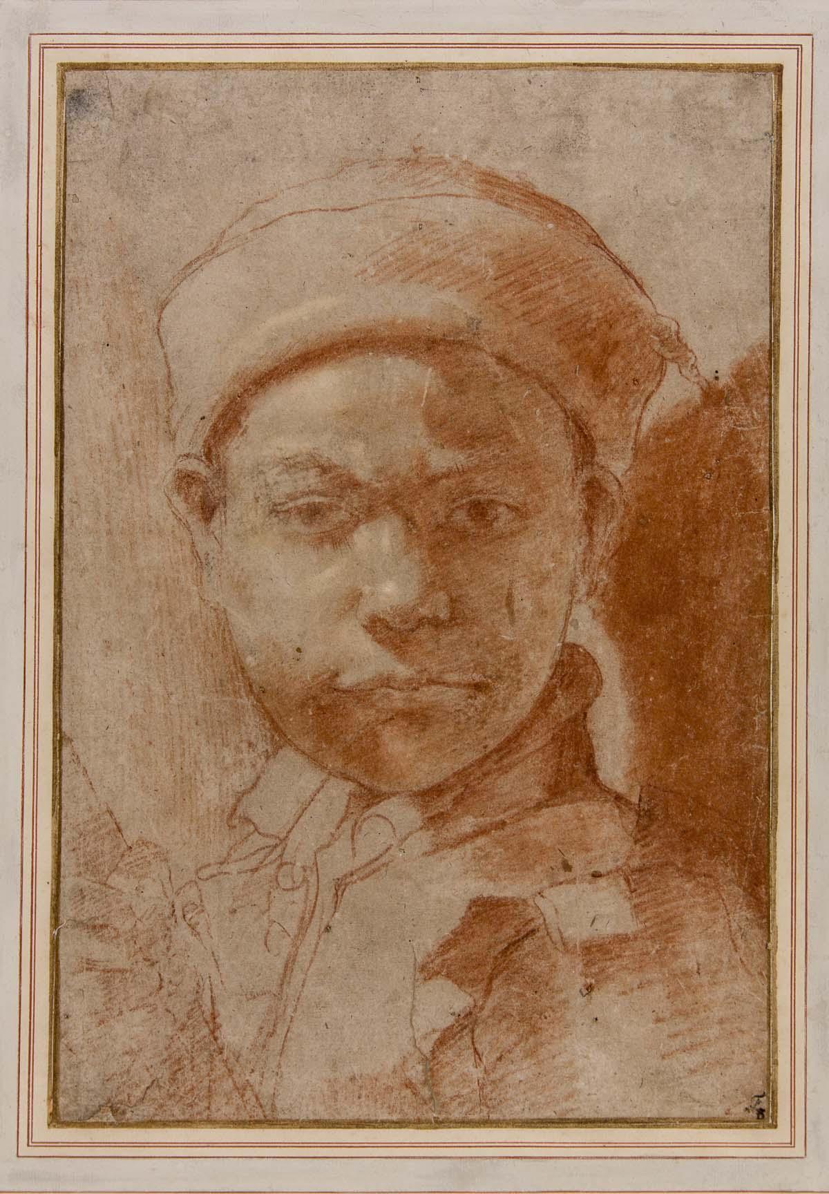 pencil portrait of a boy wearing a cap