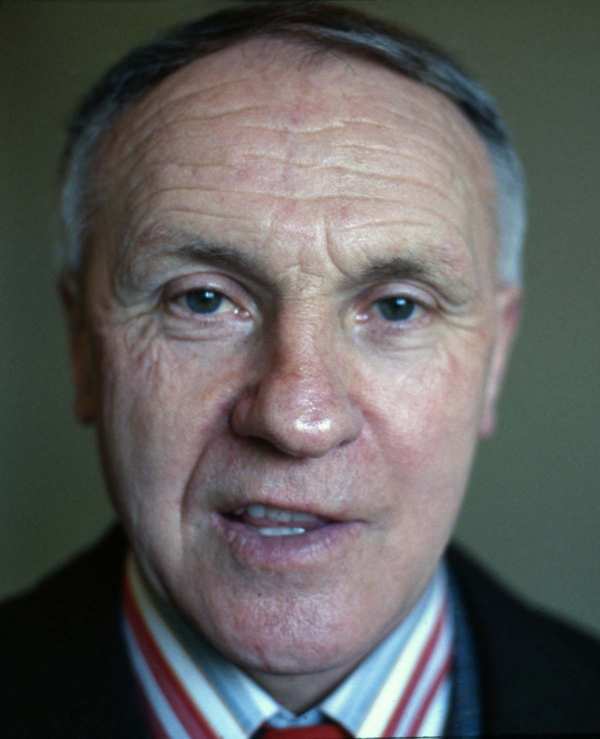 close colour portriat photograph of a man with grey hair