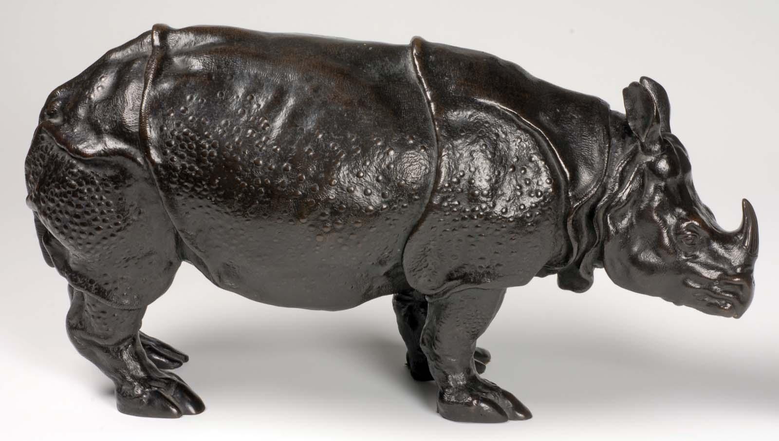 a bronze cast model of a rhinoceros
