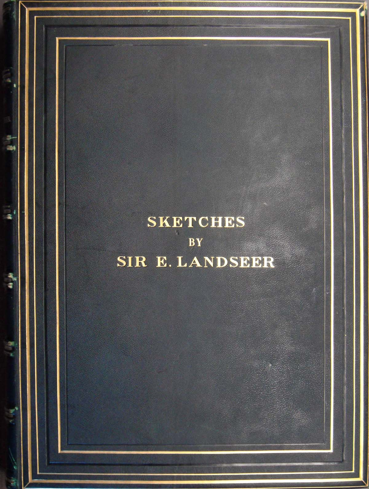 dark leather bound book cover with gold embossed lettering spelling Sketches of Sir E Landseer