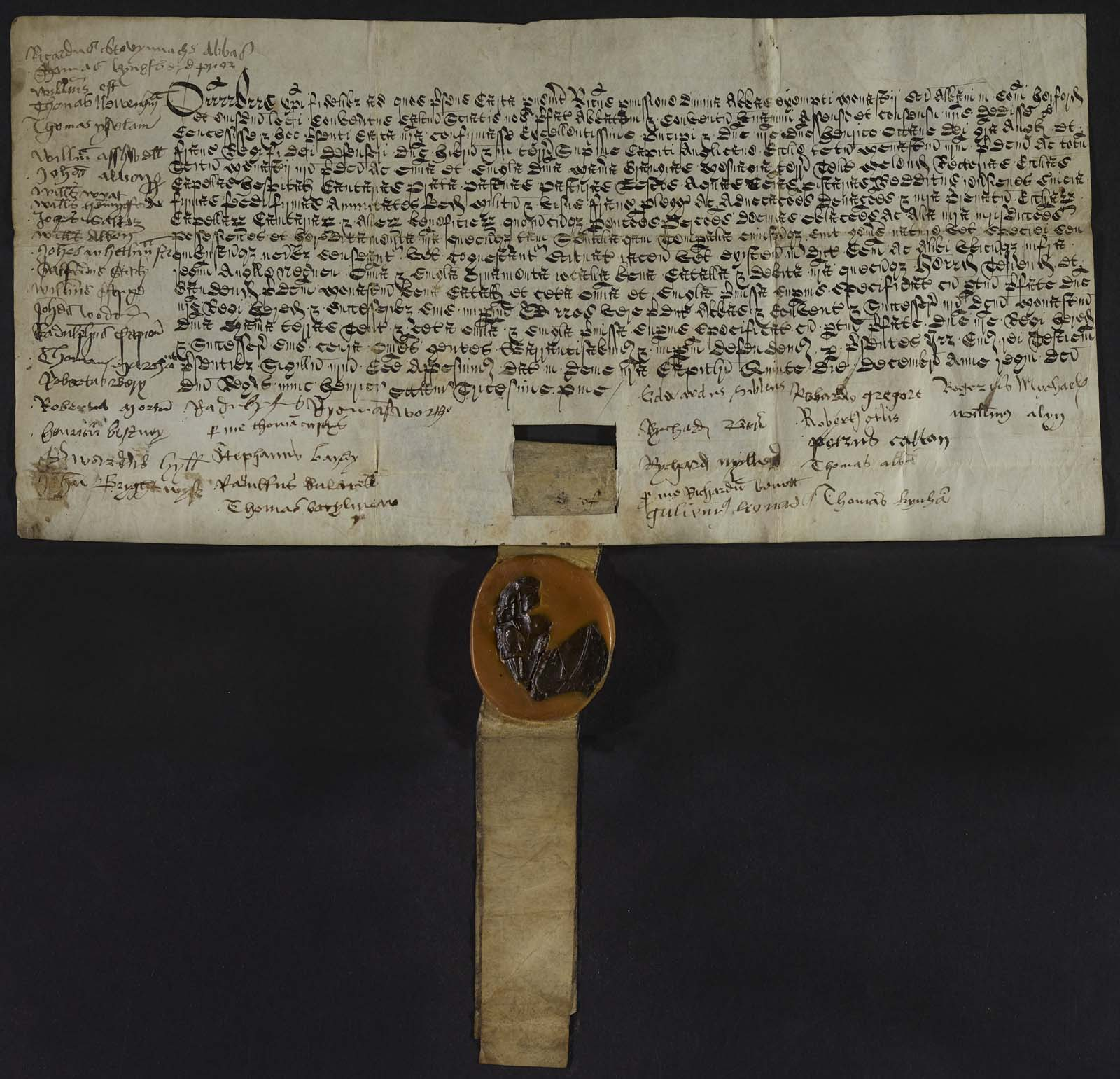 medieval deed with wax and fabric seal at the bottom